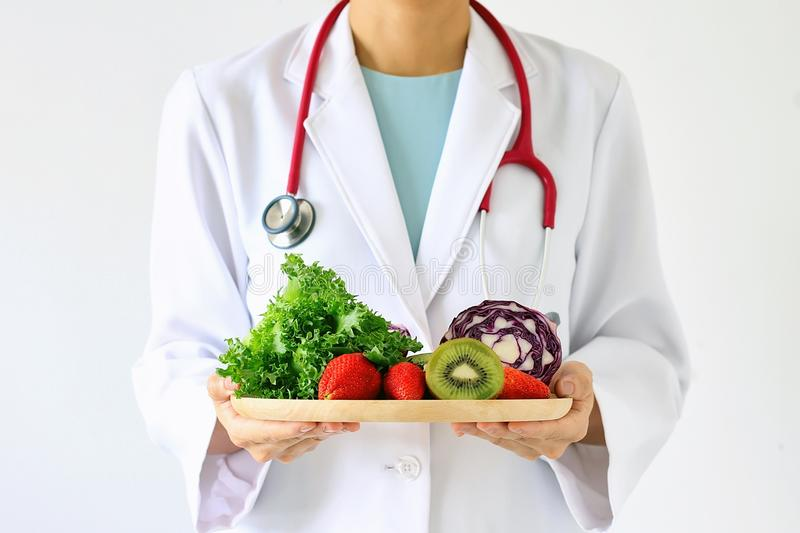 Doctor holding fresh fruit and vegetable, Healthy diet. royalty free stock photos