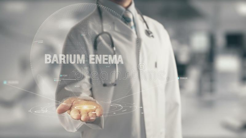 Doctor holding in hand Barium Enema. Concept of application new technology in future medicine royalty free stock photo