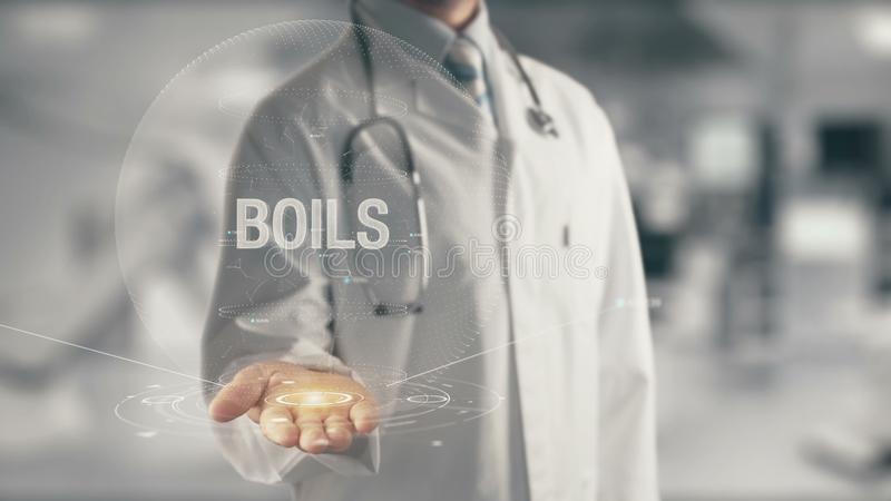 Doctor holding in hand Boils stock images