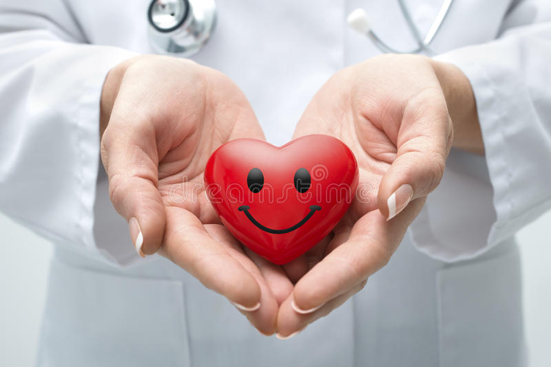 Doctor holding heart royalty free stock photos