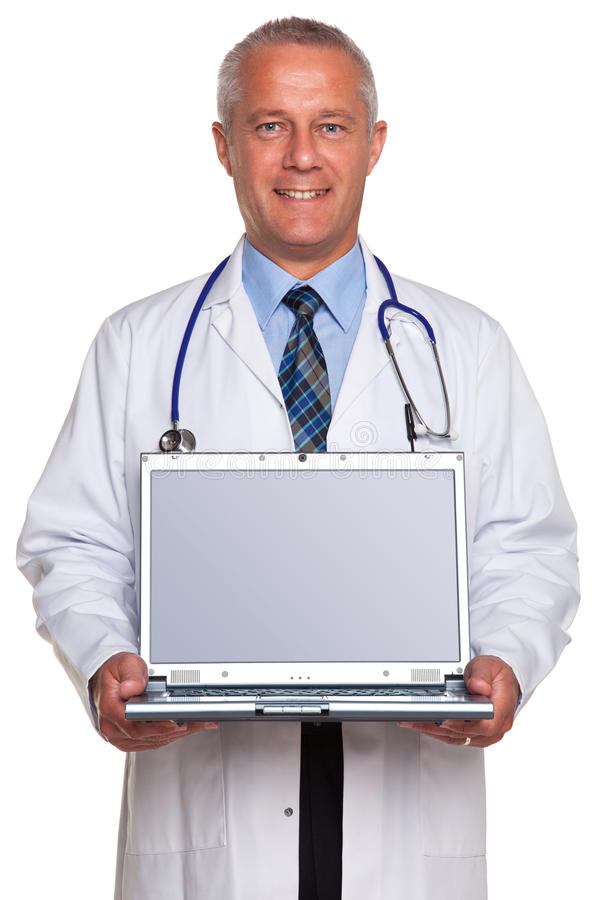 Doctor holding laptop clipping path for screen. Photo of a mature adult male doctor, smiling to camera and holding a laptop computer with clipping path for the royalty free stock image