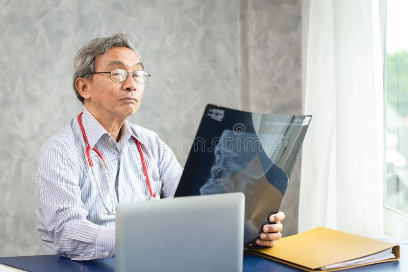 Doctor holding looking at x-ray film royalty free stock images