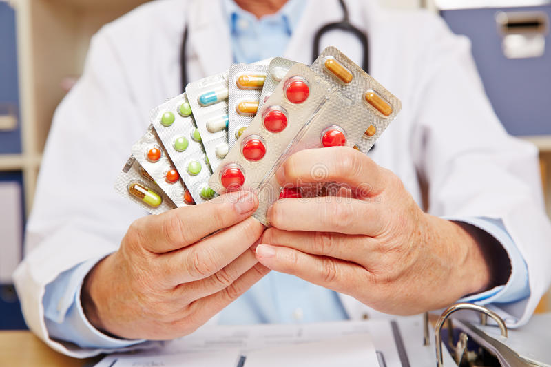 Doctor holding many prescription drugs royalty free stock images