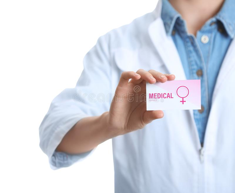 Doctor holding medical business card isolated on white. Women`s health service stock image