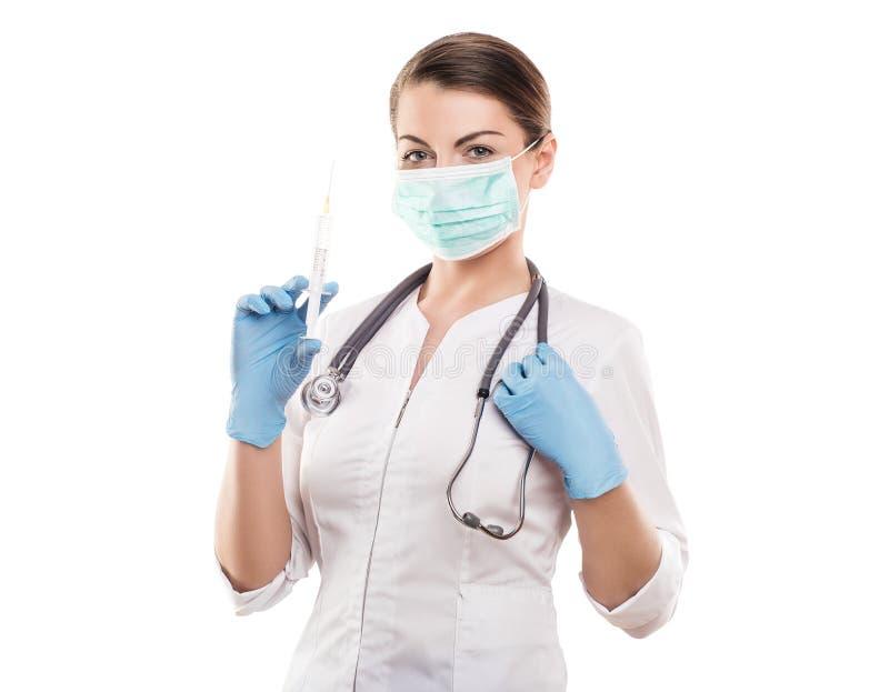 Doctor holding medical injection syringe and stethoscope, isolated stock photo