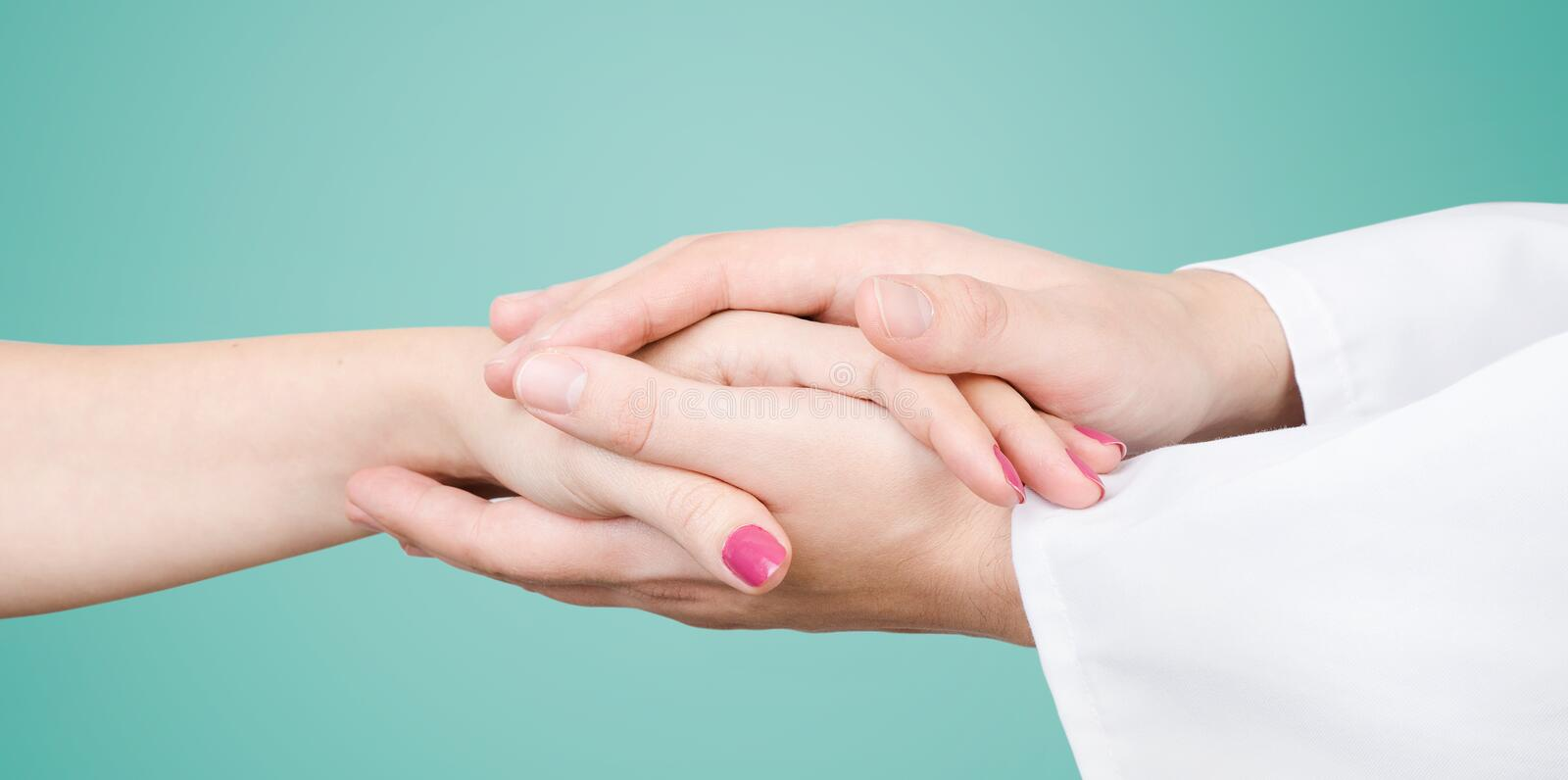 Doctor holding patient hand close up royalty free stock image