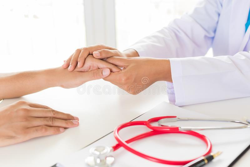 Doctor holding patient`s hand. Medicine and health care concept. royalty free stock photography