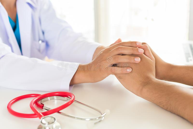 Doctor holding patient`s hand. Medicine and health care concept. royalty free stock photo