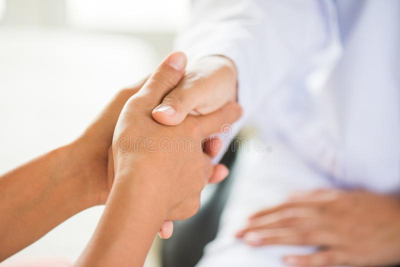 Doctor holding patients hand. Medicine and health care concept. royalty free stock images