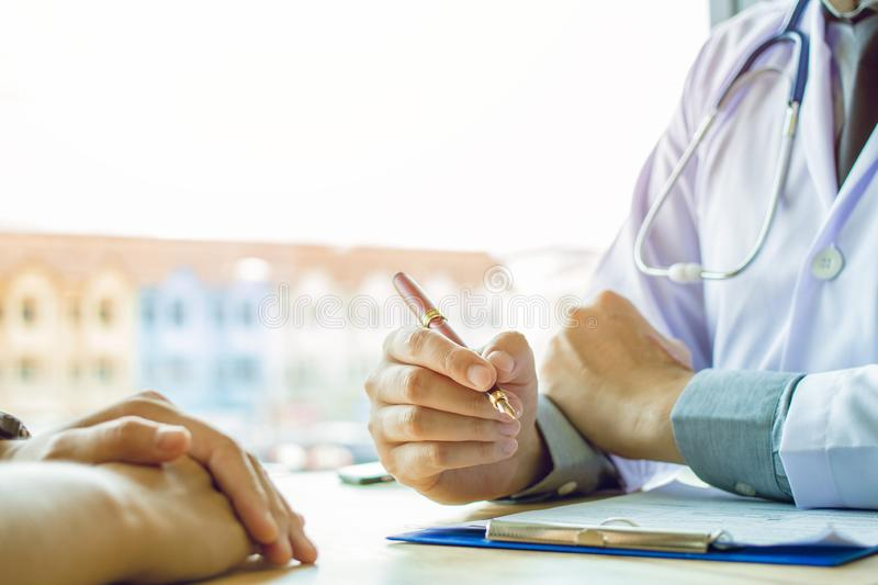 Doctor Holding Pens and Mentoring Patients, Treating Cancer and Introducing. Taking Care of Yourself royalty free stock image