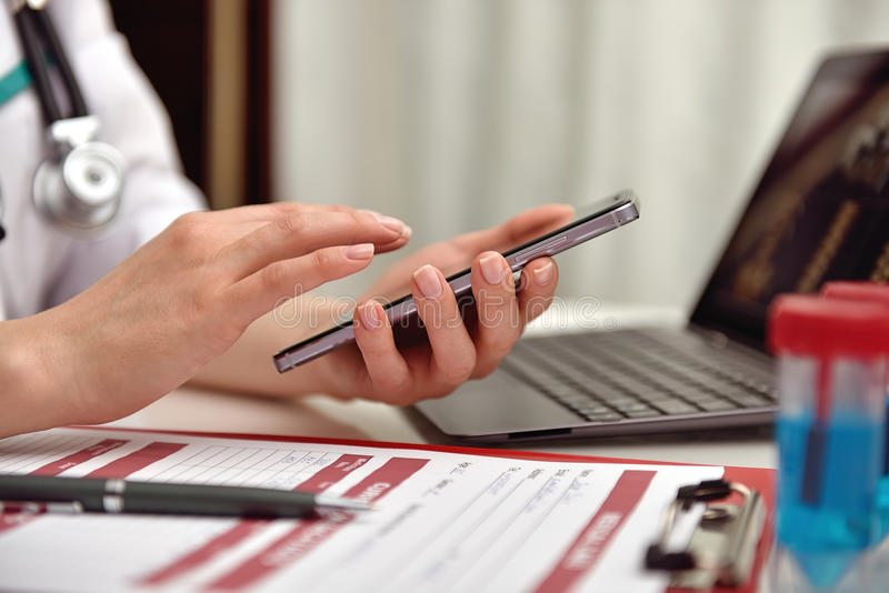 Doctor holding phone stock images