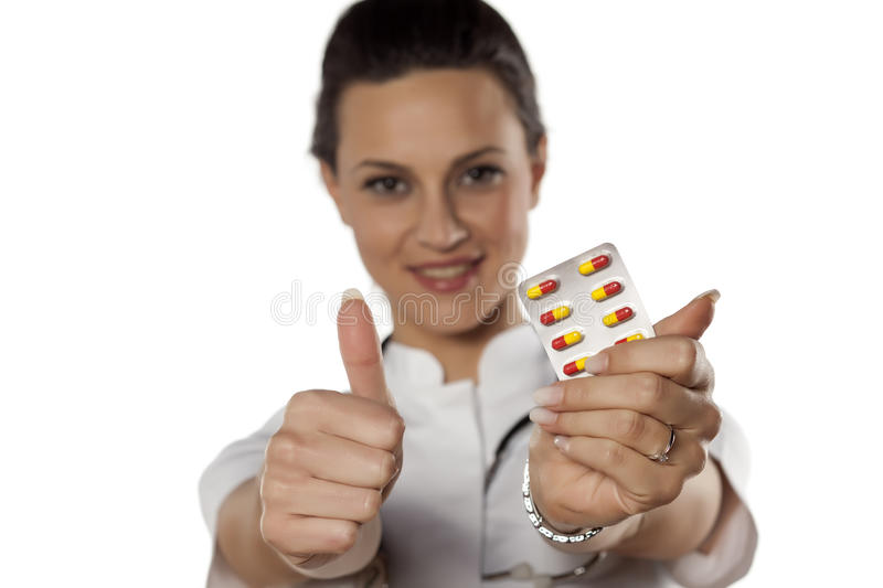 Doctor holding pills royalty free stock photos