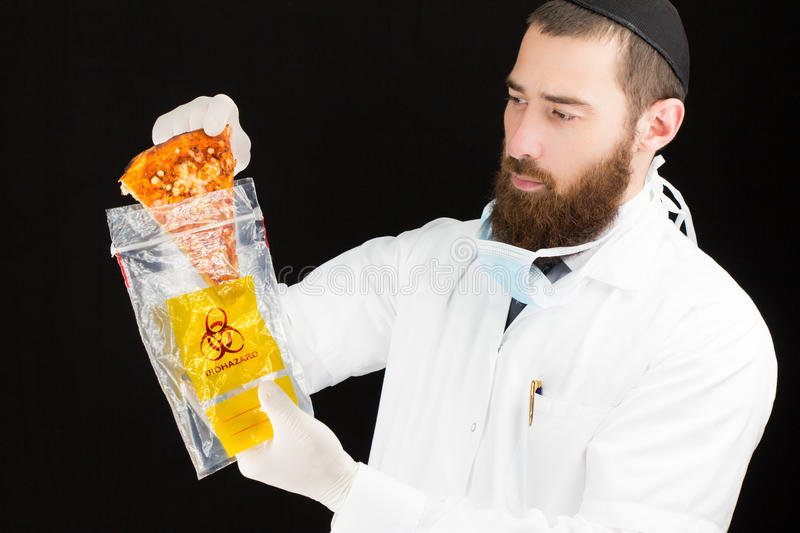 Doctor holding pizza in plastic bag. Bearded doctor holding pizza in plastic bag royalty free stock photography