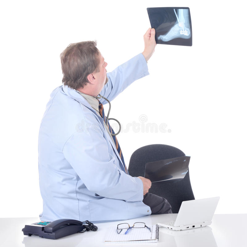 Doctor holding X-ray slide up royalty free stock photography