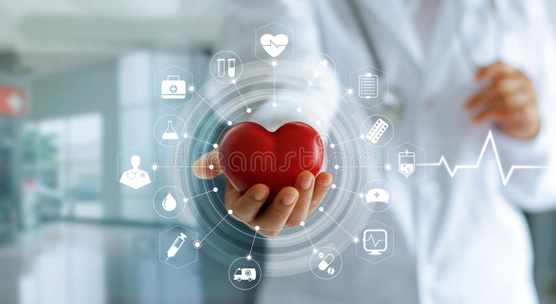 Doctor holding red heart shape in hand and icon medical. Medicine doctor holding red heart shape in hand and icon medical network connection with modern virtual stock photos
