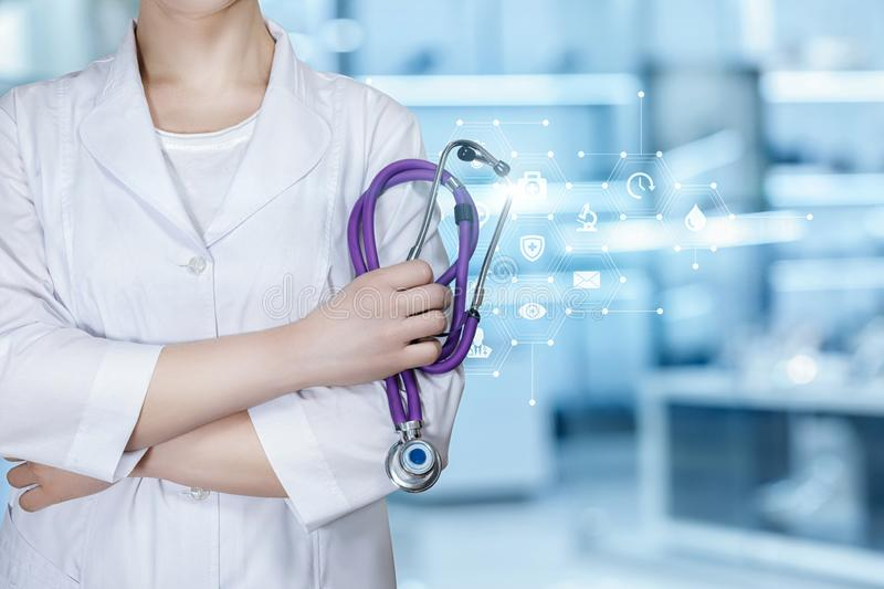 A doctor holding a stethoscope stock photos