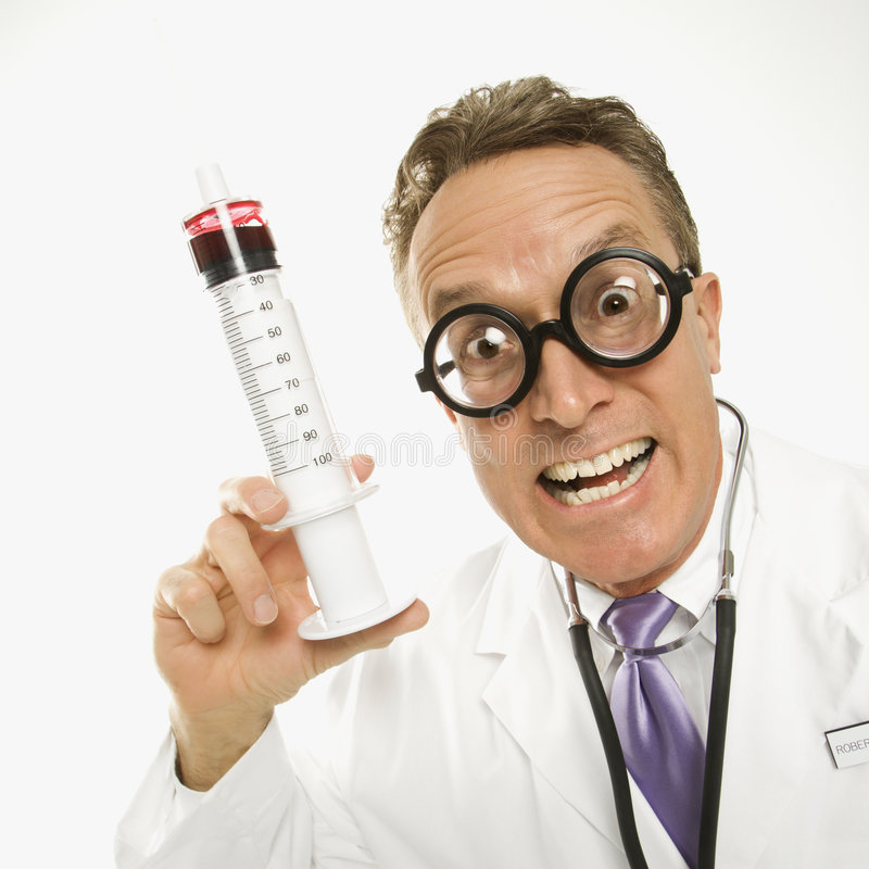 Doctor holding an syringe stock photos