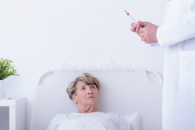 Doctor holding syringe stock photo