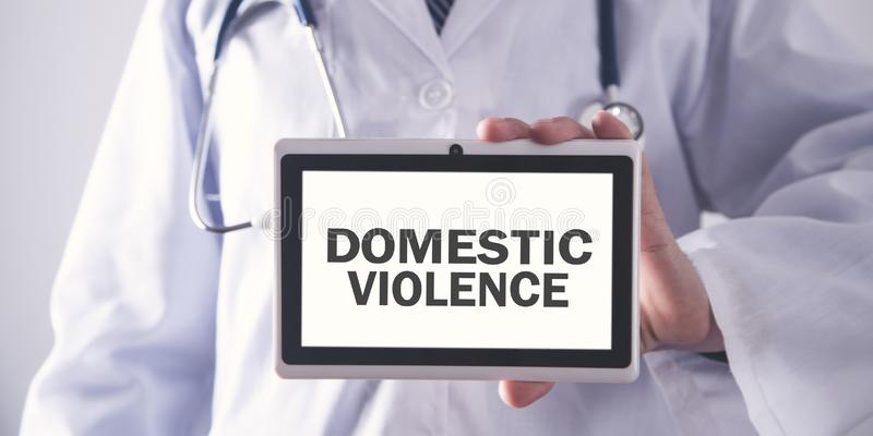 Doctor holding tablet. Domestic violence royalty free stock photography
