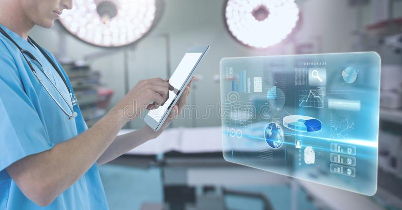 Doctor holding tablet with interface in surgery operating theatre. Digital composite of Doctor holding tablet with interface in surgery operating theatre stock images