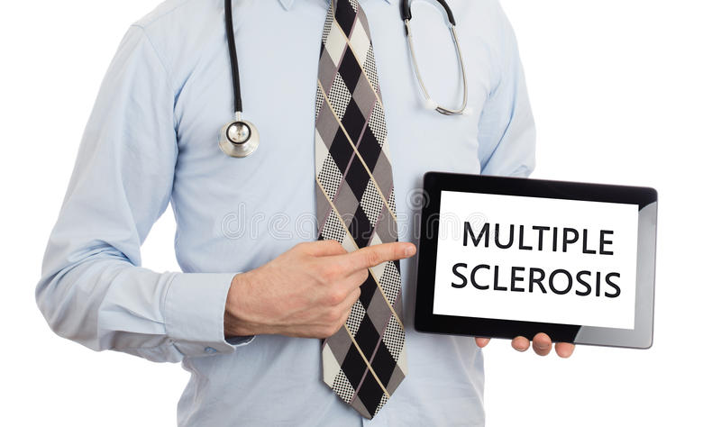 Doctor holding tablet - Multiple sclerosis stock images