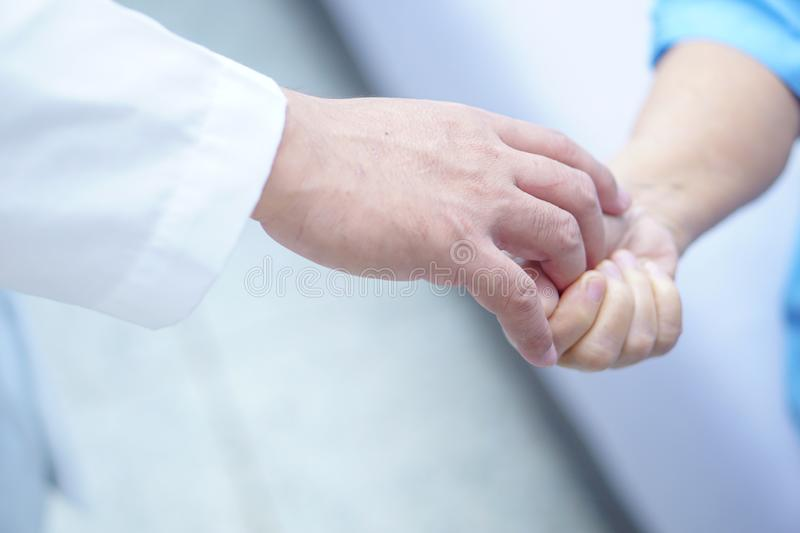 Doctor holding touching hands Asian senior or elderly old lady woman patient with love, care. Doctor holding touching hands Asian senior or elderly old lady stock photography