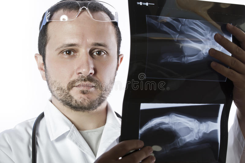 Download Doctor Holding An X-ray Appeal Of A Hand Stock Image - Image: 25757095