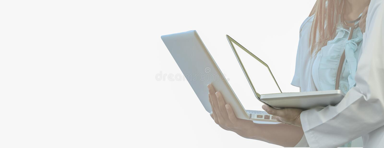Doctor holds laptop in hand, white isolated background,for Web banner horizontal panoramic style,Concepts network medical. Technology and data,treatment and stock photos