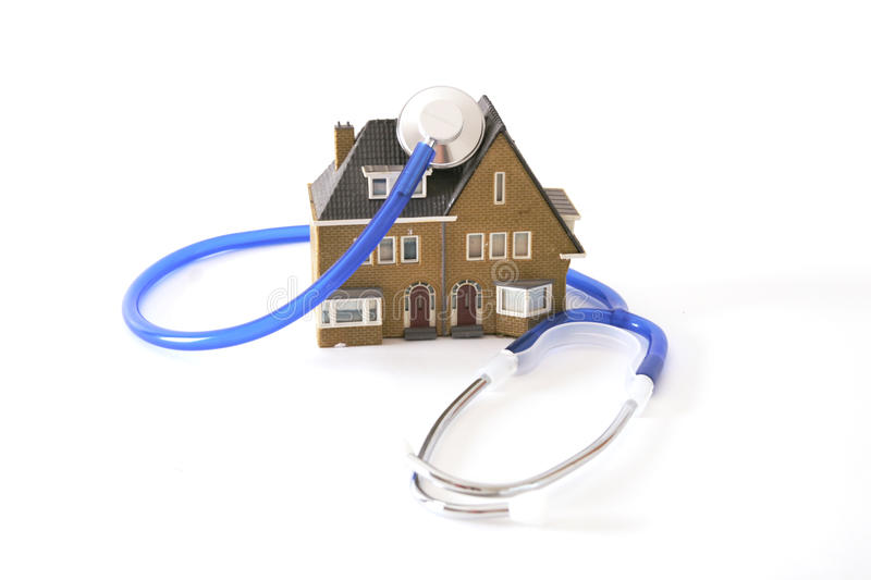 Doctor at home. Blue stethoscope around a house which means doctor visit at home stock photography