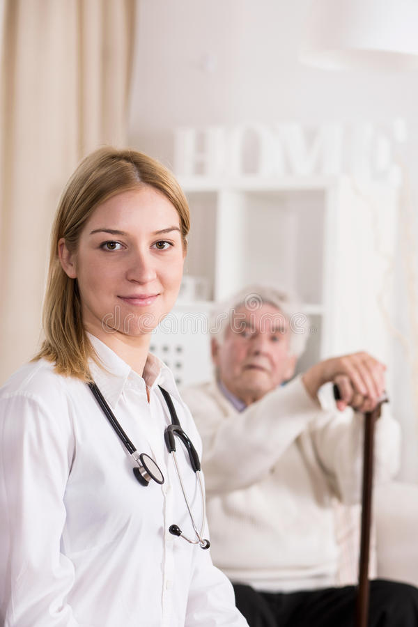 Doctor during home visit royalty free stock image