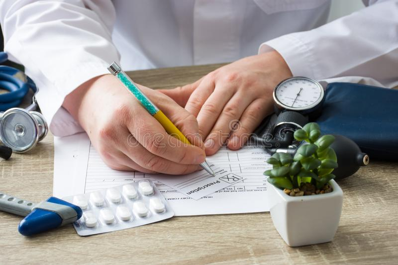 Doctor in hospital office prescribe prescription medication to patient who came to appointment. Control and monitoring of dischar. Ge of prescription drugs for royalty free stock photos