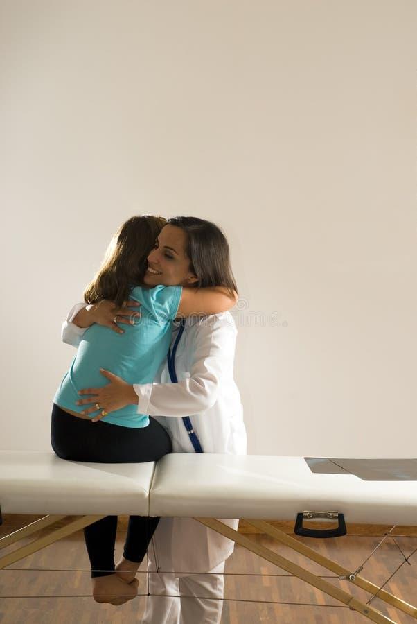 Download Doctor Hugs Girl-Vertical stock photo. Image of hispanic - 5413198