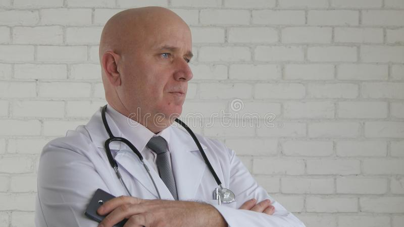 Doctor Image with Cellphone in Hand Stay Calm and Listen a Patient royalty free stock photos