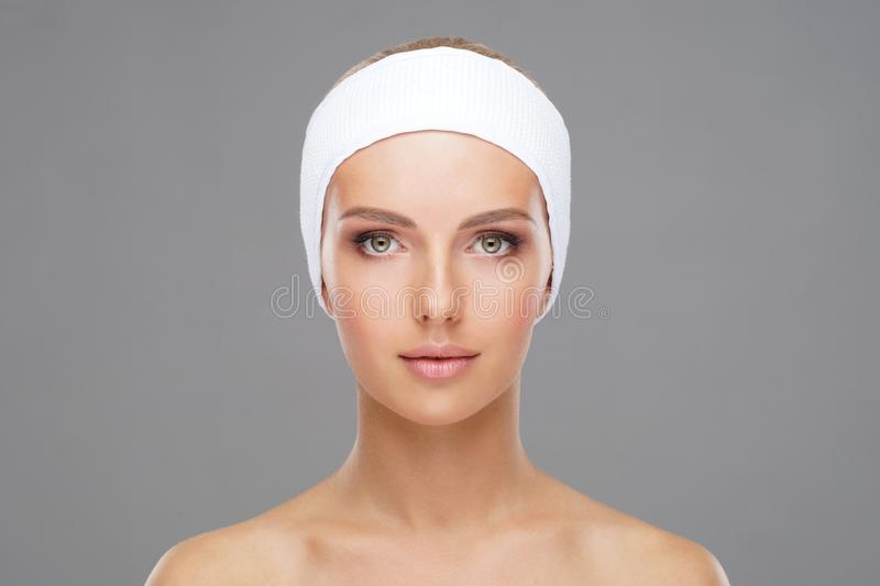 Doctor injecting in a beautiful face of a young woman. Plastic surgery concept. Doctor injecting in a beautiful face of a young woman. Plastic surgery, skin stock photo