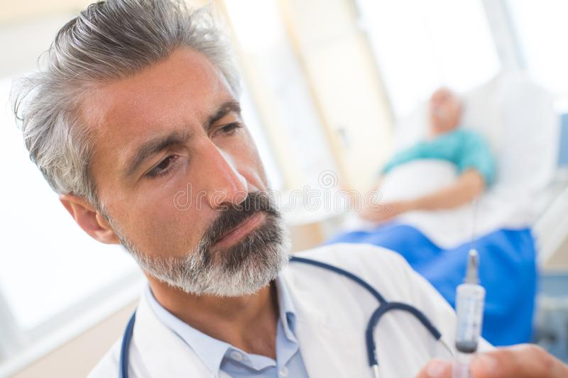 Doctor with injection needle. Doctor royalty free stock images