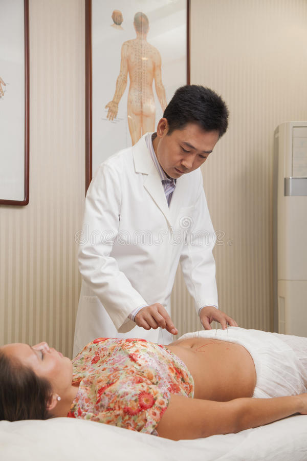 Doctor Inserting Acupuncture Needles royalty free stock photography