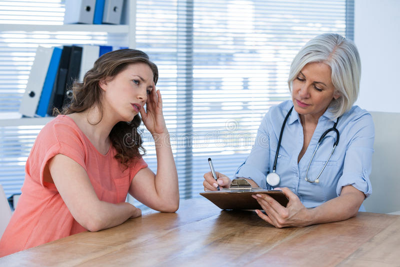 Doctor interacting with patient royalty free stock image