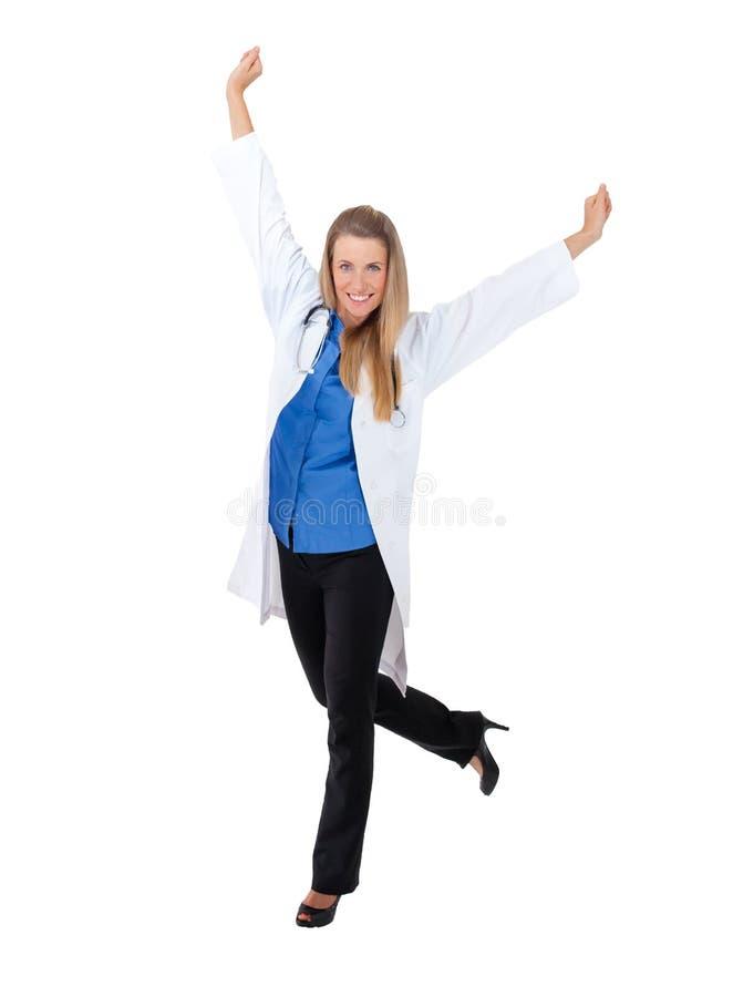 Doctor joven que se coloca en el copyspace blanco foto de archivo libre de regalías