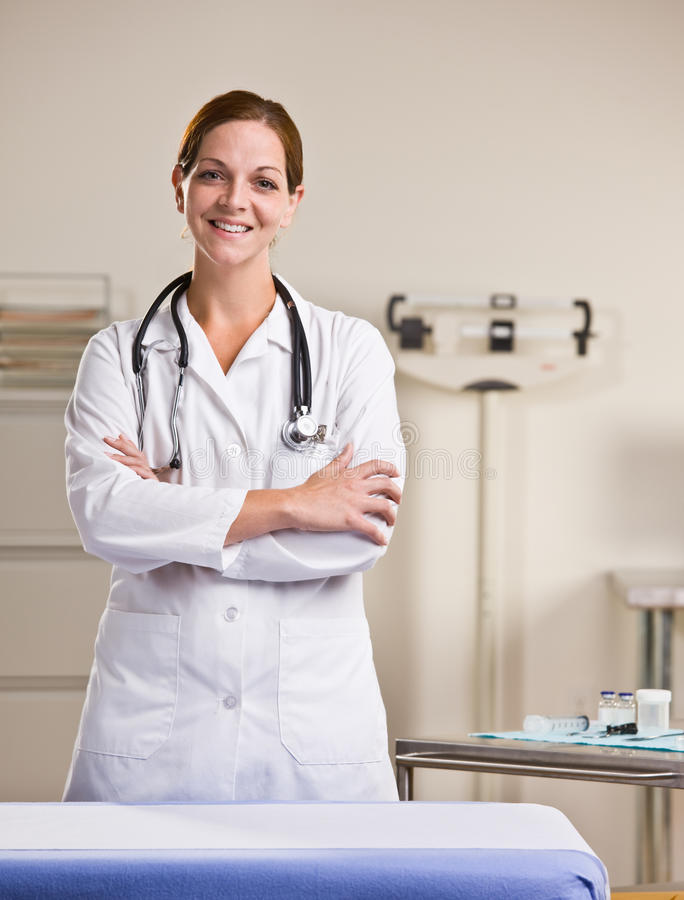 Doctor in lab coat in doctor office stock photos
