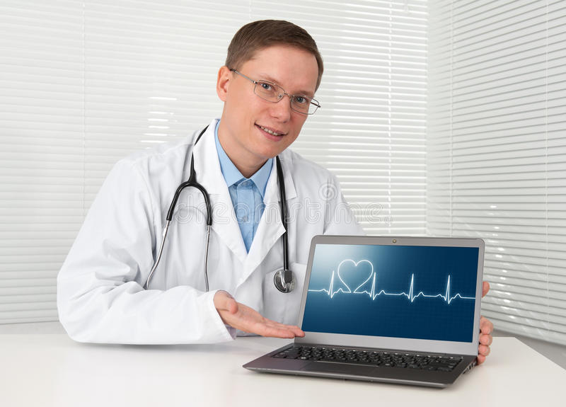 Download Doctor In Lab Coat With Laptop Stock Photo - Image: 26410388