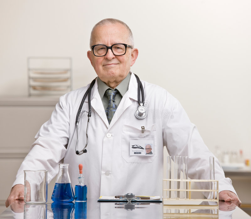 Doctor In Lab Coat And Stethoscope Stock Image