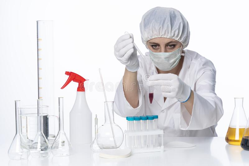 Doctor In Laboratory Conducting  Blood Analysis  stock photography