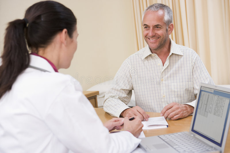 Download Doctor With Laptop And Man In Doctor's Office Stock Photo - Image: 5928854