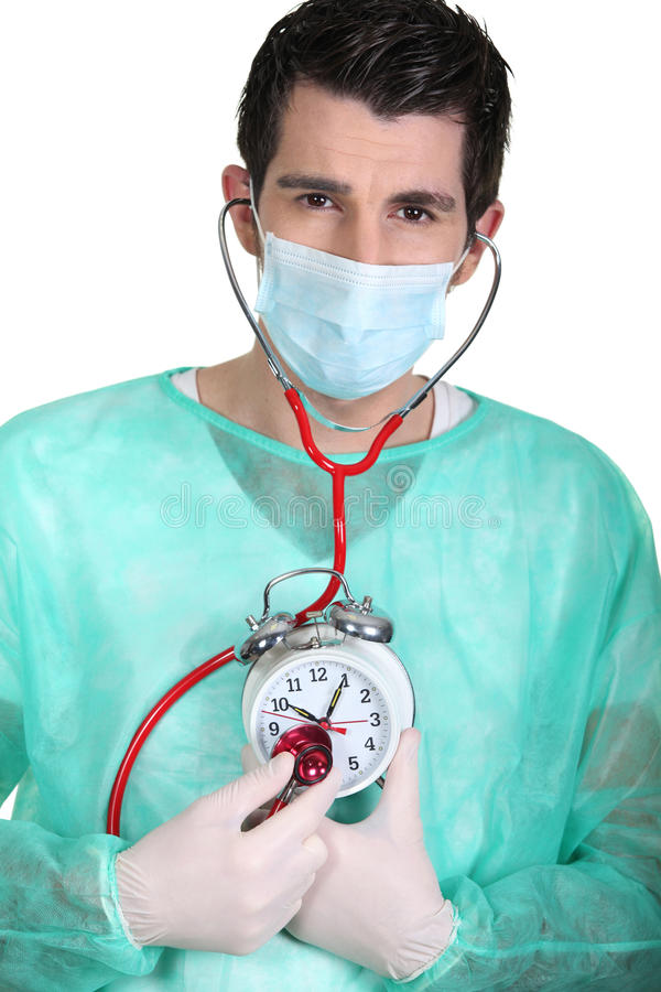 Free Doctor Listening To A Clock Stock Images - 35930874