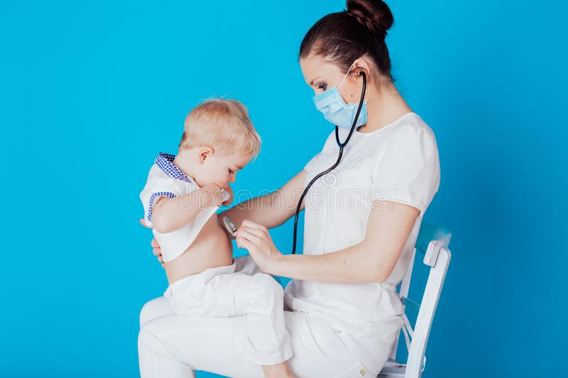 Doctor Listens To Lungs Of Boy With Stethoscope Stock