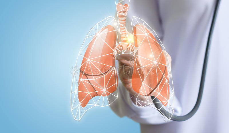 Doctor listens to the lungs. stock photos