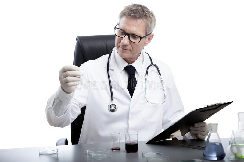 Doctor look and analyse blood test tube royalty free stock photos