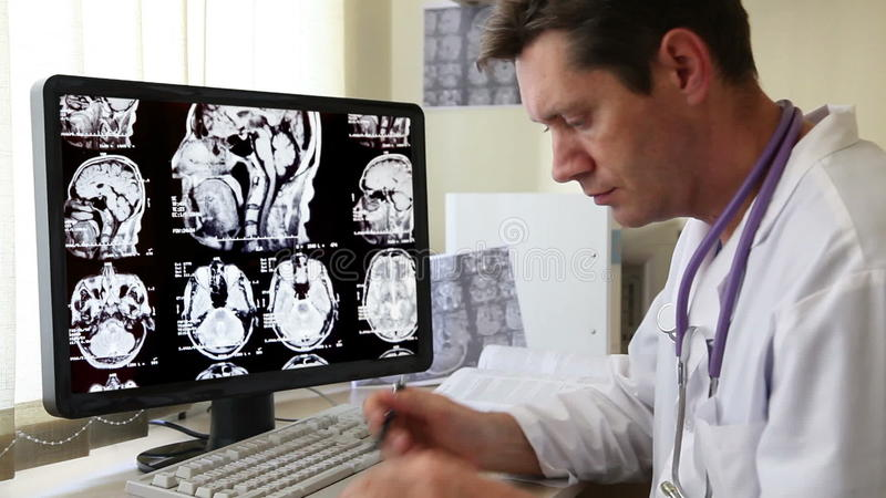 Doctor looking at CT scan. Doctor in Hospital looking at CT scan stock footage