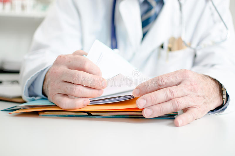 Doctor looking for a file royalty free stock image