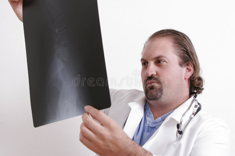 Doctor looking at a film stock photos